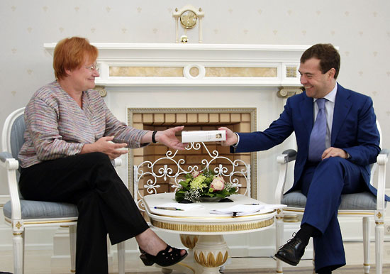 Russian President Dmitry Medvedev (right) presents a book to Finnish President Tarja Halonen during informal talks in Sochi on August 11, 2009.